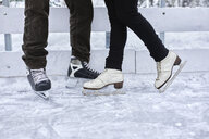 Couple standing at the ice rink - ZEDF01840