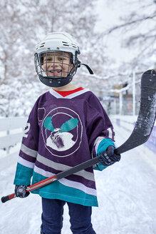 Portrait of a boy in ice hockey gear - ZEDF01867