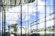 Germany, Berlin, view to Paul-Loebe-Building, Marie-Eisabeth-Lueders-Building mirrored in the glass facade - PUF01364