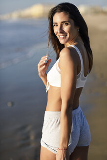 Portrait of smiling beautiful woman on the beach - JSMF00778