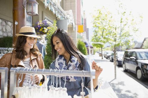 Women shopping on village street - HEROF08081