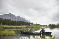 Three generations of men fishing in lake - HEROF08093