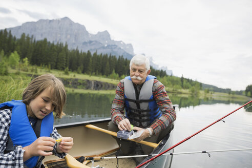 Older man and grandson fishing in lake - HEROF08228