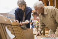 Older couple shopping at outdoor market - HEROF08375