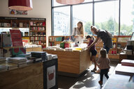 Family shopping in bookstore - HEROF08399