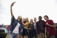 Confident teenagers taking selfie with smart phone - HEROF08510