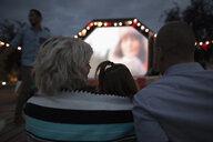 Family enjoying movie in the park - HEROF08531