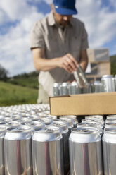 Man canning outside distillery - HEROF08714