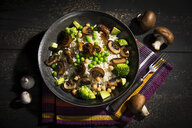 Vegan dish: natural rice with champignons, peas, chick peas, avocado and broccoli - MAEF12778