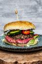 Hamburger with beetroot hummus, cucumber, tomato and salad - SARF04066