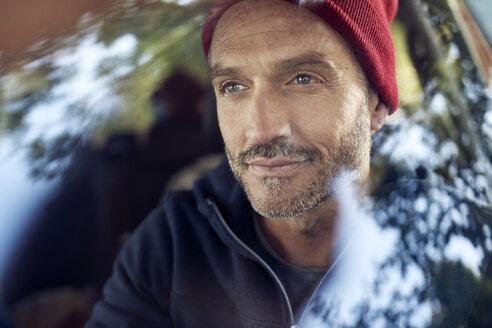 Portrait of bearded mature man behind windscreen - PNEF01193