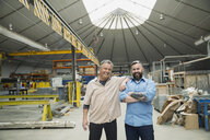 Portrait of confident workers in manufacturing plant - HEROF09019