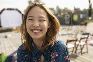 Portrait smiling, enthusiastic teenage girl in park - HEROF09214
