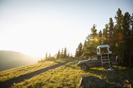 SUV with rooftop tent on sunny, idyllic mountain hilltop, Alberta, Canada - HEROF09334