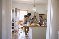 Family enjoying breakfast in kitchen - HEROF09523