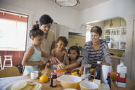 Family preparing breakfast in kitchen - HEROF09526