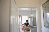 Man using digital tablet in kitchen - HEROF09532
