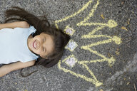 Enthusiastic girl with sidewalk chalk crown overhead - HEROF09568