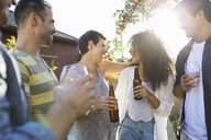 Friends drinking and hanging out at backyard barbecue - HEROF09592