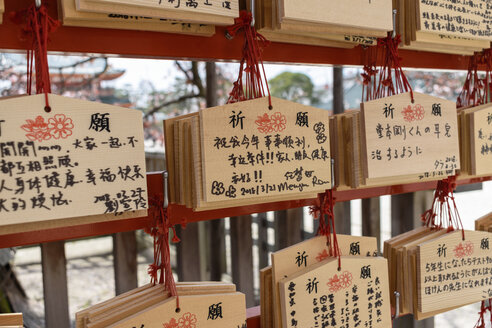 Close up of Ema, wooden prayer boards, Japan. - MINF10082