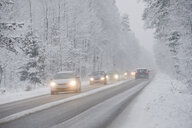 Cars driving on country road in winter, driving snow - CRF02825