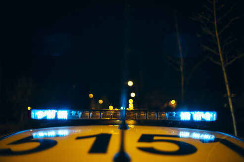 Spain, Madrid, close-up of police car sirens with the lights of the city in background - OCMF00231