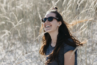 South Africa, Western Cape, Hout Bay, portrait of laughing young woman in the dunes - LHPF00399