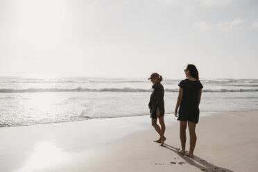 South Africa, Western Cape, Noordhoek Beach, two young women strolling on the beach - LHPF00405