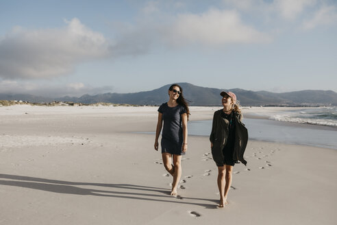 South Africa, Western Cape, Noordhoek Beach, two young women strolling on the beach - LHPF00408