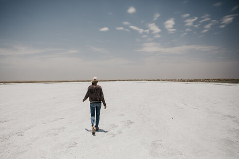 Namibia, Walvis Bay, woman walking on a salt plain - LHPF00420