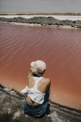 Namibia, Walvis Bay, woman sitting at Pink Lagoons - LHPF00423