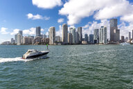 USA, Florida, skyline of Downtown Miami with motorboat on the water - MABF00517