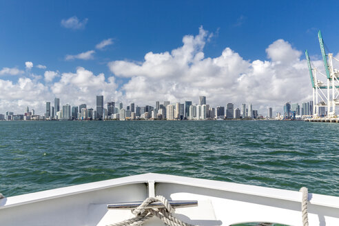 USA, Florida, skyline of Downtown Miami seen from boat on the water - MABF00520