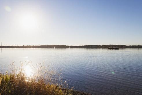 Germany, Saxony, Leipzig, Lake Cospuden in backlight - GWF05832
