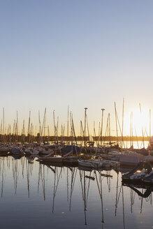 Germany, Saxony, Leipzig, Markkleeberg, Lake Cospuden, Marina, Pier 1 at sunset - GWF05835