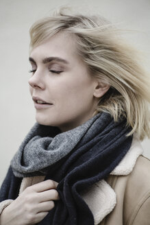 Portrait of blond young woman wearing scarf - JESF00222