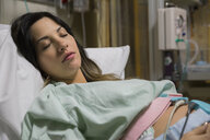 Sleeping pregnant woman in hospital bed - HEROF09791