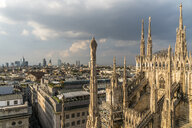 Italy, Milan, pinnacles and spires of Milan Cathedral and cityscape - PC00394