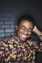 Portrait of laughing man wearing patterned shirt - HEROF10067
