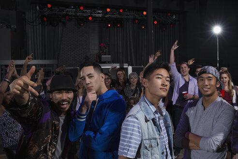 Portrait of confident men among crowd in nightclub - HEROF10124