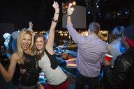 Portrait of cheering women dancing in nightclub - HEROF10127