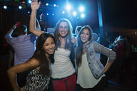 Portrait of smiling friends in nightclub - HEROF10139