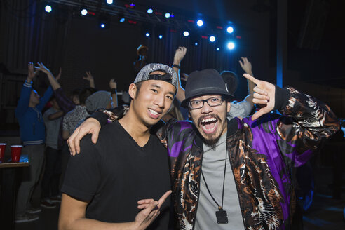 Portrait of enthusiastic men at nightclub - HEROF10142