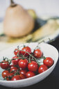 High angle close up of bowl of fresh tomatoes on the vine. - MINF10285