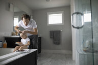 Father checking toddler daughter s hair for lice - HEROF10309