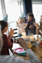 Happy multi-generation family celebrating toddler girl s birthday at dining table - HEROF10324