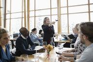 Female sommelier leading wine tasting in restaurant - HEROF10378