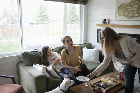 Mother and teenage daughters in living room, playing video game - HEROF10536
