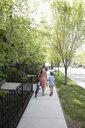 Mother and son walking with bicycle on neighborhood sidewalk - HEROF10587
