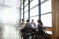 Business people dining at restaurant table - HEROF10717